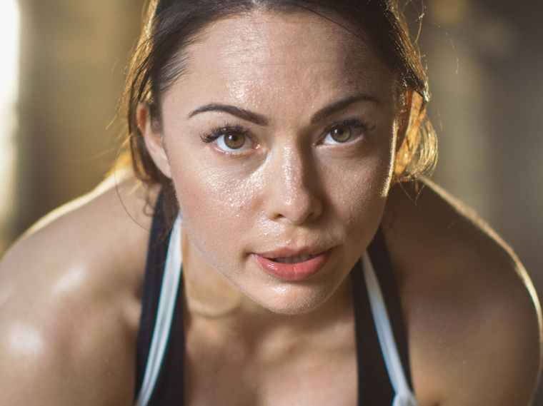 woman-sweating-Getty-header